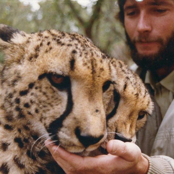 man in zimbabwe with cheetah four generations